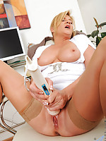 Mature Ginger Lynn tames her horny pussy with her vibrating wand toy while she is alone in the office